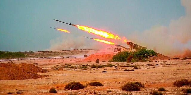 The missiles are fired in a military exercise of the Revolutionary Guard.  The Iranian Paramilitary Revolutionary Guard fired a rocket from a helicopter aimed at a model aircraft in the strategic Strait of Hormuz.  (Sepahnews via AP)