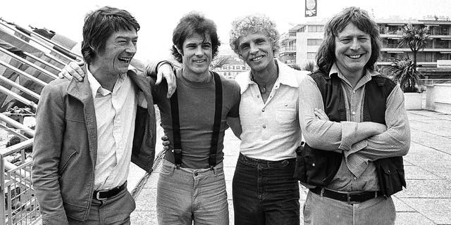 FILE - British actor John Hurt, from left, American actor Brad Davis, author Billy Hayes, and British director Alan Parker appear in Cannes, France for their film screening