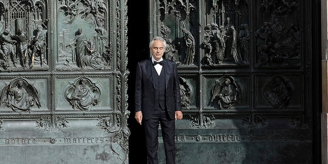 FILE - This Sunday, April 12, 2020, Italian singer Andrea Bocelli performs at the Duomo, in Milan, Italy.  (AP Photo / Luca Bruno, file)