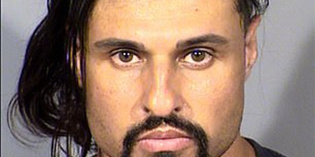 Ash Armand is accused of beating a female victim to death in Las Vegas, Nev.