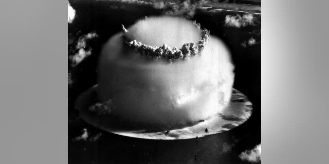 "FILE--A huge mushroom cloud rises above Bikini atoll in the Marshall Islands July 25, 1946 following an atomic test blast, part of the U.S. military's ""Operation Crossroads."" (AP Photo/file)"