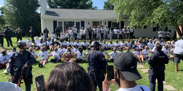 Over 100 demonstrators marched from a local high school in Louisville to the attorney general's home to demand he charge the three officers involved in Taylor's death.