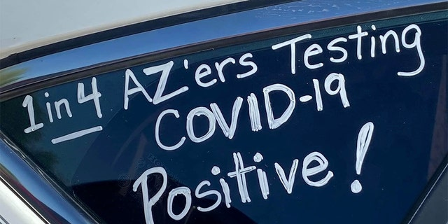 """A slogan is seen on a car in """"a motor march"""" protest of teachers who took it to their vehicles to demand a delay in in-person learning in the fall, due to the coronavirus disease (COVID-19) outbreak, in Phoenix, Arizona, U.S., July 15, 2020. Picture taken July 15, 2020. REUTERS/Kelley Fisher NO RESALES. NO ARCHIVES - RC2NVH9P22JL"""