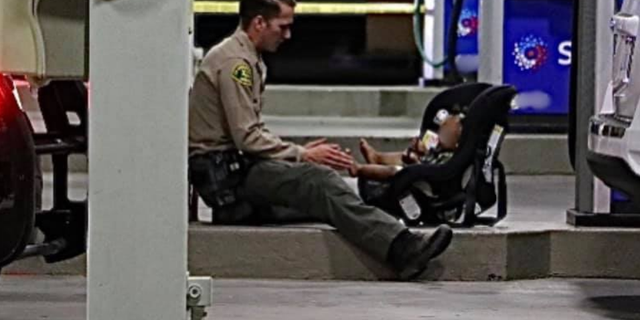 The Lancaster Sheriff's Station posted a picture showing Deputy Josef Schirmeister sitting next to the child to comfort and distract him.