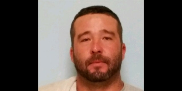 "Chad Lee Houser, 37, made his escape from Central Prison in Raleigh on the evening of July 10 wearing ""blue hospital-style scrubs"" even after a guard thought he looked suspicious and stopped him. (North Carolina Department of Public Safety)"