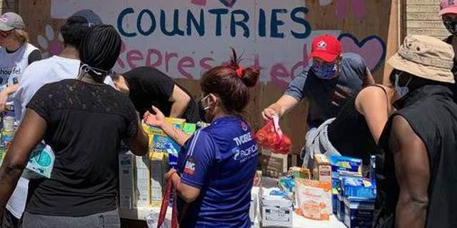 Volunteers give out food and essentials in Minneapolis.