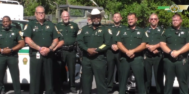 Clay County Sheriff Darryl Daniels is standing center with a hat on in this still image taken from a viral video he posted earlier this week. (Courtesy: Clay County Sheriff's Office)