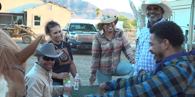 Lanette Campbell (top left), founder of the Arizona Black Rodeo can be seen sharing a laugh with fellow cowgirls and cowboys.