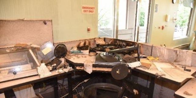 Damage to a work area inside the Portland Justice Center's Corrections Records Office.