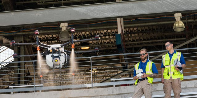 Drone operators are practicing inside the Cotton Bowl stadium, waiting for FAA approval.