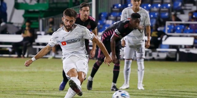 Los Angeles FC forward Diego Rossi (9) scores on a penalty kick against the Seattle Sounders during the first half of an MLS soccer match in Kissimmee, Fla., Monday, July 27, 2020. (AP Photo/Reinhold Matay)
