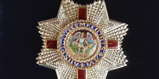 The Insignia of an Honorary Dame Grand Cross of the Most Distinguished Order of St Michael and St George has been criticized for its imager in the wake of the death of George Floyd.
