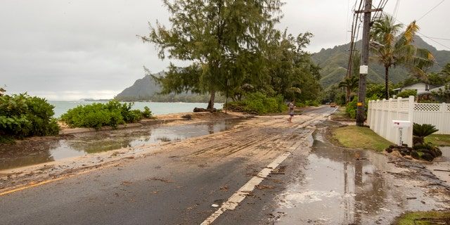 Sand and debris is left on Kamehameha Highway from high surf generated by Hurricane Douglas, Sunday, July 26, 2020, in Hauula, Hawaii.