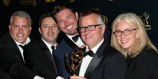 "Producers Jonathan Norman, Andy Lassner, Kevin Leman, Ed Glavin and Mary Connelly pose with the award for Outstanding Talk Show Entertainment for ""The Ellen DeGeneres Show"" in the press room during The 42nd Annual Daytime Emmy Awards at Warner Bros. Studios on April 26, 2015 in Burbank, Calif."