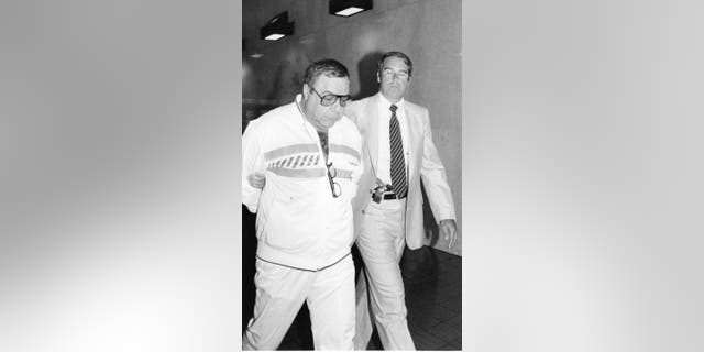 Queens, New York: Angelo Ruggiero, a member of organized crime .is under arrest at FBI offices on Queens Blvd. in Rego Park, N.Y. on June 20, 1986.