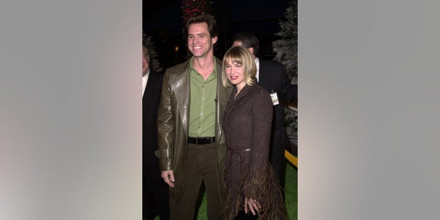 """Jim Carrey and Renee Zellweger during """"The Grinch"""" premiere at Universal City Amphitheatre in Universal City in Los Angeles."""