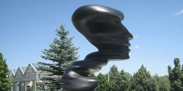 "The 15-foot bronze sculpture, ""Bent of Mind,"" by Tony Cragg, graces the entrance to Frederik Meijer Gardens and Sculpture Park in Grand Rapids, Mich."