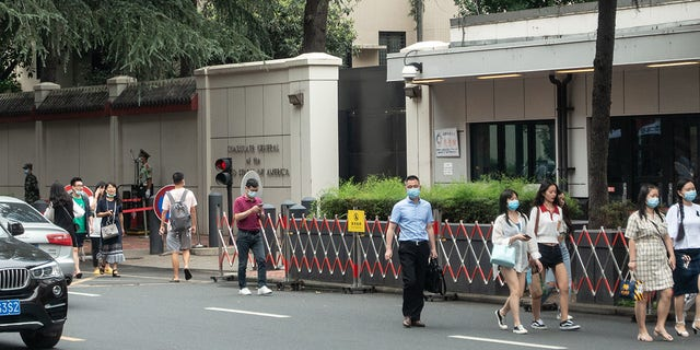 CHENGDU, CHINA - JULY 23: People walk by the US Consulate-General in Chengdu on July 23, 2020 in Chengdu, Sichuan Province of China. (Photo by VCG via Getty Images)