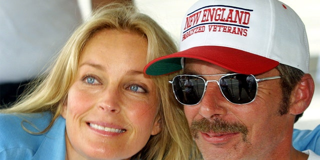 Actress Bo Derek poses with disabled veteran Jim Wallack at the National Veterans Wheelchair Games July 4, 2001, in New York City.