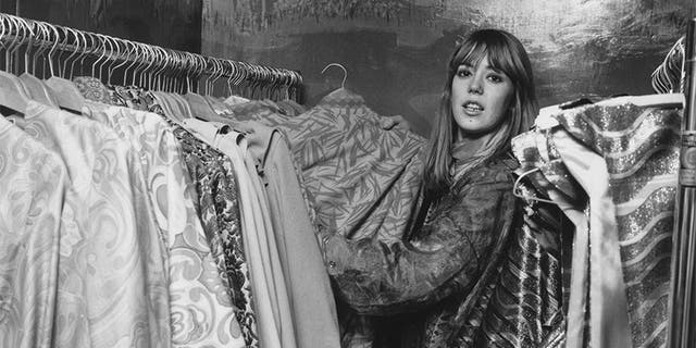 Jenny Boyd, sister-in-law of Beatle George Harrison, helps out at Apple, the Beatles clothes boutique in Baker Street, London, circa 1967.