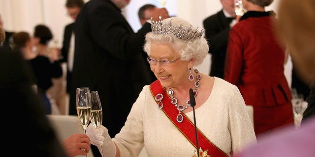 Queen Elizabeth II toasts guests after giving a speech during a State Banquet at the Schloss Bellevue Palace on the second day of a four day State Visit on June 24, 2015 in Berlin, Germany.