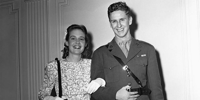 Lieutenant Cord Meyer, Jr., USMC, aide to Commander Harold Stassen, with his bride, the former Mary Pinchot, daughter of the late Amos Pinchot and niece of the former Governor of Pennsylvania, Gifford Pinchot, after their marriage at the home of the bride, 1165 Park Ave.