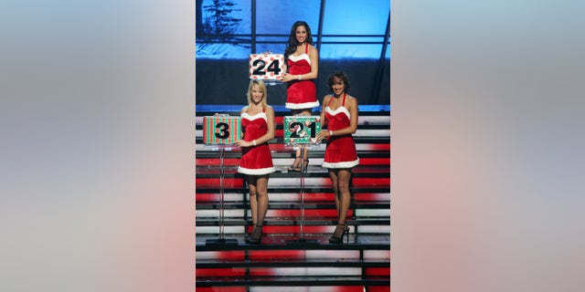 DEAL OR NO DEAL -- Episode 235 -- Pictured: (l-r) Lisa Gleave (3), Tameka Jacobs (21), Meghan Markle (24)