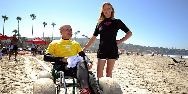 US Army Veteran Joseph Smith (L) chats with US actress Bo Derek after a surfing lesson during the 2nd National Veterans Summer Sports Clinic in San Diego, California on September 25, 2009. The National Veterans Summer Sports Clinic introduces recently injured Veterans to adventure sports and recreational activities such as surfing, sailing, cycling, or kayaking. During one week, organized by the US Department of Veterans Affairs, they promote rehabilitation of body and spirit. US actress Bo Derek is supporting the program as a volunteer.