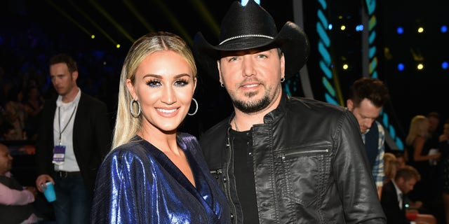 Brittany and Jason Aldean were criticized for not wearing masks while taking a pic inside Disneyworld.