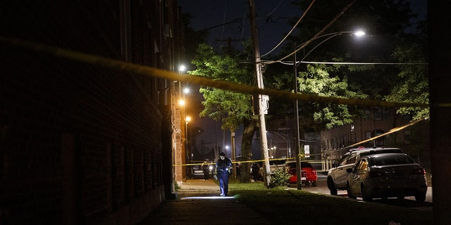 Police work the scene where a 19-year-old man was shot in the 400 block of West 77th Street in Chicago on July 3, 2020.