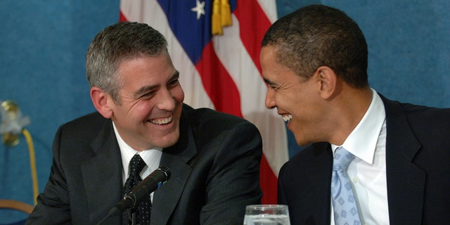 Actor George Clooney (L) and Senator Barack Obama (D - Illinois) during a press conference in Washington DC, where Clooney spoke about his recent visit to the Darfur region of Sudan, on April 27, 2006. (Photo by ImageCatcher News Service/Corbis via Getty Images)