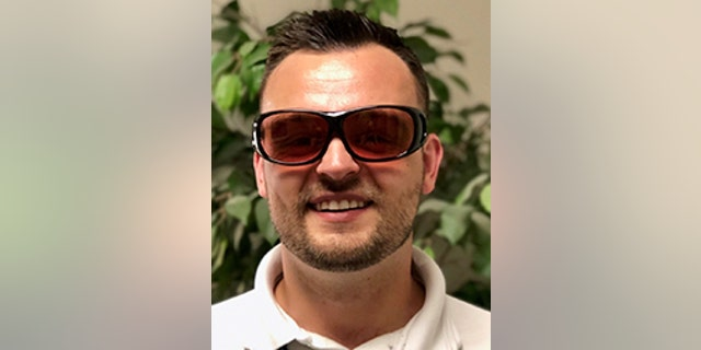 Study participant Alex Zbylut wearing glasses designed to address color blindness.