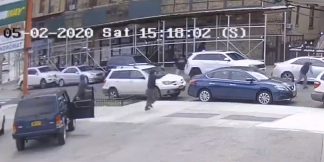 Screen grab from surveillance video showing gunmen emerging from SUV and chasing Pagans Motorcycle Club leader Frank Rosado, 51, down a Bronx street on May 2.