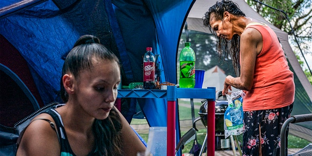 Julia Rainey, left and her mother Tonya Rainey live next to each other in a tent compound.  (Photo by Richard Tsong-Taatarii/Star Tribune via Getty Images)