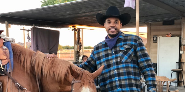 Shaheed Muhammad, pictured with his horse Shaka, moved from Los Angeles to Arizona to become a cowboy.