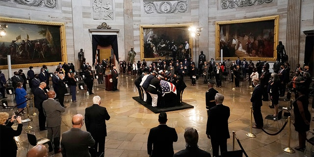 The flag-draped casket of the late Rep. John Lewis, D-Ga.,is placed on the catafalque by a joint services military honor guard, where it will lie in state, Monday, July 27, 2020 at the Capitol in Washington. (AP Photo/J. Scott Applewhite, Pool)
