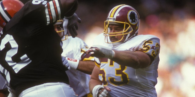 WASHINGTON - OCTOBER 13: Jeff Bostic #63 of the Washington Redskins makes a block during a NFL football game against the Cleveland Browns on October 13, 1991 at RFK Stadium in Washington DC. (Photo by Mitchell Layton/Getty Images)