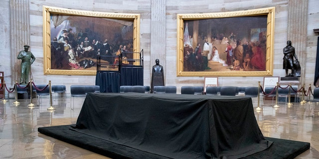 A bust of Martin Luther King, Jr., center, is visible behind the catafalque for the casket of the late Rep. John Lewis, D-Ga., in the center of the U.S. Capitol Rotunda in Washington, Friday, July 24, 2020, before he lies in state Monday. Lewis, who carried the struggle against racial discrimination from Southern battlegrounds of the 1960s to the halls of Congress, died Friday, July 17, 2020. (AP Photo/Andrew Harnik)