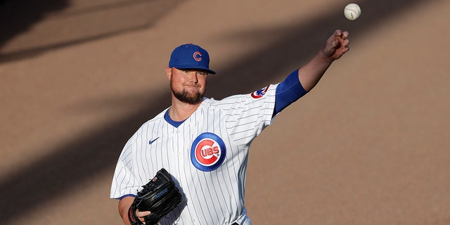 Chicago Cubs pitcher Jon Lester warms up before an intrasquad baseball game at Wrigley Field in Chicago, Friday, July 17, 2020. (AP Photo/Nam Y. Huh)