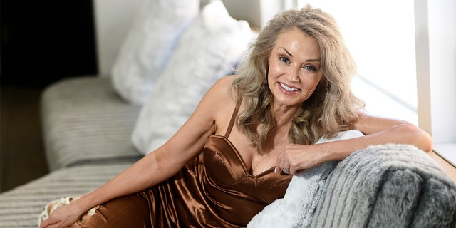 Model Kathy Jacobs poses for a portrait at her home in Calabasas, Calif. on Friday, July 17, 2020. Jacobs has made her Sports Illustrated swimsuit issue debut at age 56. The 2020 Sports Illustrated Swimsuit issue is online and on newsstands Tuesday. (AP Photo/Chris Pizzello)