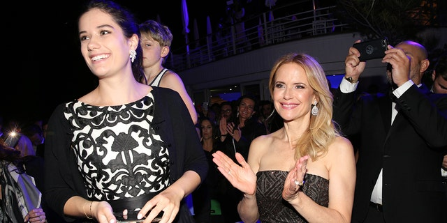 Kelly Preston's daughter, Ella, pays tribute to 'courageous' mother following her death