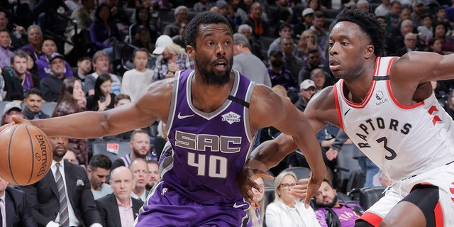 SACRAMENTO, CA - MARCH 8: Harrison Barnes #40 of the Sacramento Kings drrives against OG Anunoby #3 of the Toronto Raptors on March 8, 2020 at Golden 1 Center in Sacramento, California. NOTE TO USER: User expressly acknowledges and agrees that, by downloading and or using this photograph, User is consenting to the terms and conditions of the Getty Images Agreement. Mandatory Copyright Notice: Copyright 2020 NBAE (Photo by Rocky Widner/NBAE via Getty Images)