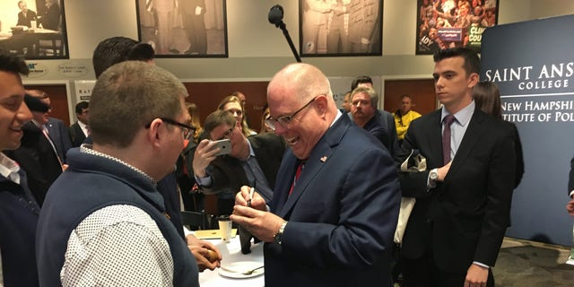 Maryland Gov. Larry Hogan signs the famed wooden eggs during a visit to the New Hampshire Institute of Politics as he mulled a primary challenge against President Trump, in Manchester, N.H. on April 23, 2019