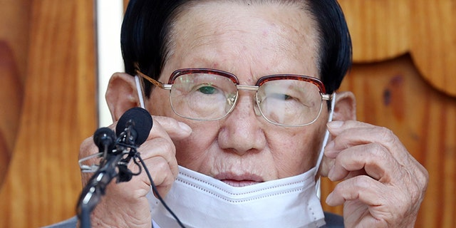 "Lee Man-hee, a leader of Shincheonji Church of Jesus, attends at a press conference in Gapyeong, South Korea, Monday, March 2, 2020. In the hastily arranged news conference Lee, the 88-year-old leader of a religious sect which has the country's largest cluster of infections, bowed down on the ground twice and apologized for causing the ""unintentional"" spread of the recent coronavirus disease. (Kim Ju-sung/Yonhap via AP)"