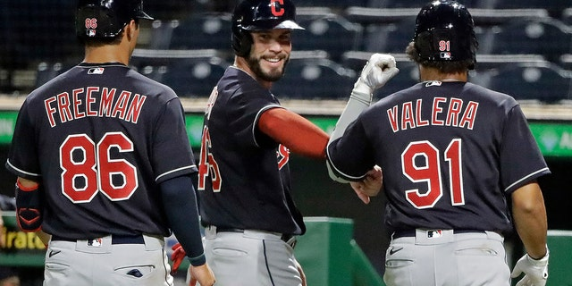 Tyler Freeman (86), Beau Taylor, center, and George Valera celebrate after scoring on a double by Indians' Christian Arroyo off Pittsburgh Pirates relief pitcher Kyle Crick during the eighth inning of an exhibition baseball game in Pittsburgh, Saturday, July 18, 2020. (AP Photo/Gene J. Puskar)
