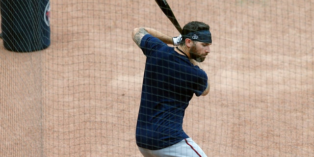 Minnesota Twins third baseman Josh Donaldson takes a practice swing during baseball practice Wednesday, July 8, 2020, in Minneapolis. The baseball team added Donaldson among a couple of potentially high impact players to the team that won 101 games last season. (AP Photo/Jim Mone)