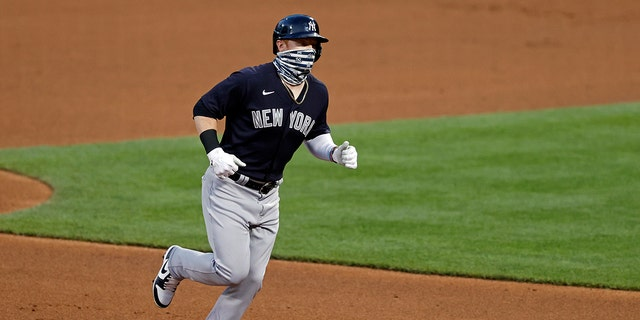 New York Yankees' Clint Frazier rounds the bases after hitting a two-run home run against the New York Mets during the fourth inning of a baseball spring training game Saturday, July 18, 2020, in New York. (AP Photo/Adam Hunger)
