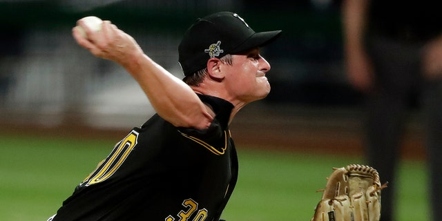 Pittsburgh Pirates relief pitcher Kyle Crick delivers during the eighth inning of an exhibition baseball game against the Cleveland Indians in Pittsburgh, Saturday, July 18, 2020. (AP Photo/Gene J. Puskar)