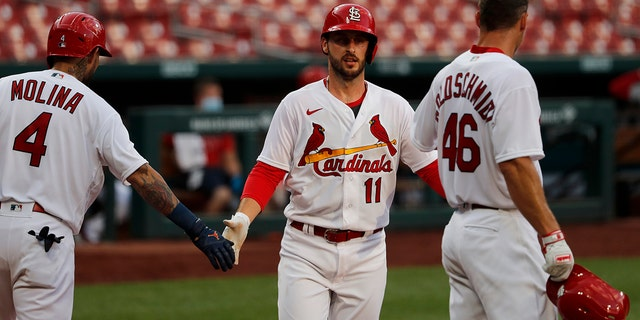 St. Louis Cardinals' Paul DeJong (11) is congratulated by teammates Yadier Molina (4) and Paul Goldschmidt (46) after hitting a two-run home run during an intrasquad practice baseball game at Busch Stadium Thursday, July 9, 2020, in St. Louis. (AP Photo/Jeff Roberson)