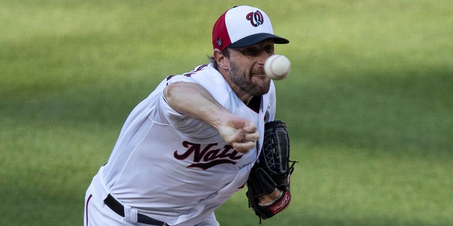 Washington Nationals starting pitcher Max Scherzer throws during the first inning of an exhibition baseball game against the Philadelphia Phillies at Nationals Park, Saturday, July 18, 2020, in Washington. (AP Photo/Alex Brandon)